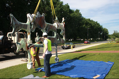 Putting the east wall sculpture on the ground
